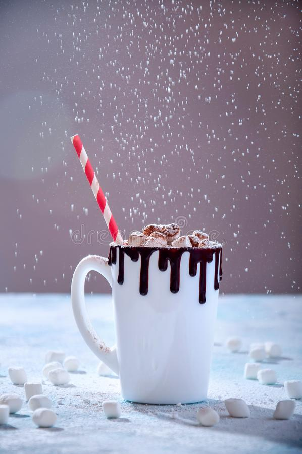 Christmas Hot Drink. White Cup of Cocoa or Chocolate with Marshmallows and Flying Powdered Sugar on Light Background.  royalty free stock photos