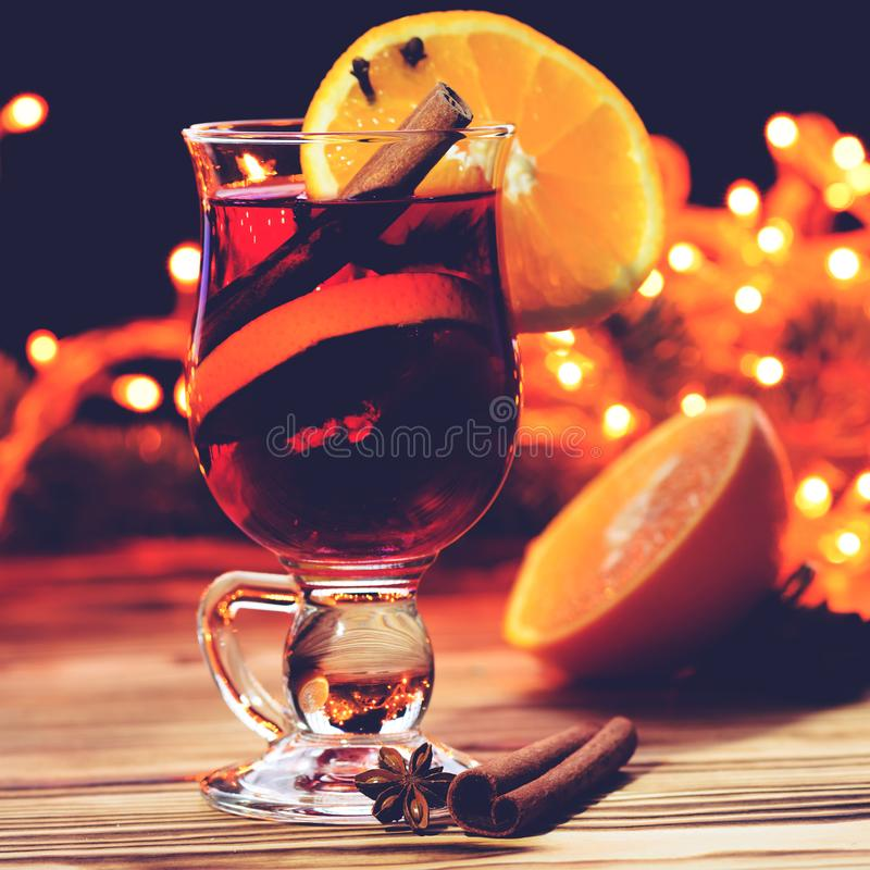 Christmas hot mulled wine in a glass with spices, anise, slice o royalty free stock photography