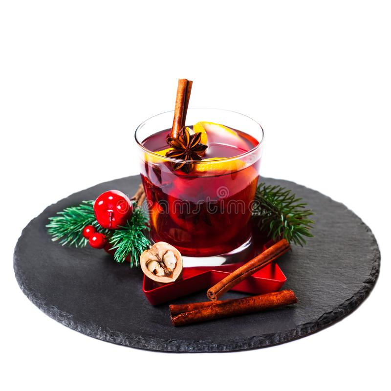 Christmas Hot mulled wine for winter with spices isolated on white background, traditional drink on winter holidays, closeup. royalty free stock images