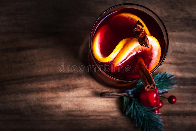 Christmas Hot mulled wine for winter with spices and orange slices on rustic table with copy space. Red Hot wine or gluhwein wit royalty free stock photo