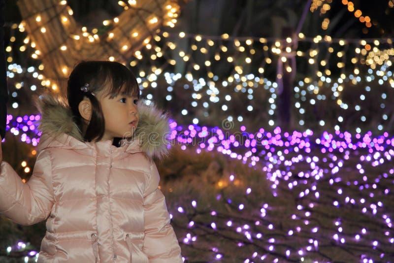 Christmas illumination and Japanese girl. 3 years old stock photos