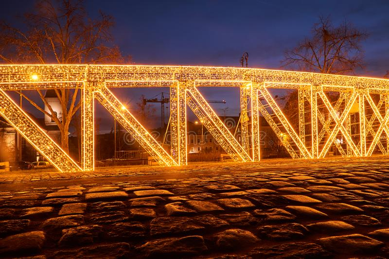 Christmas illumination in the shape of a bridge structure stock image