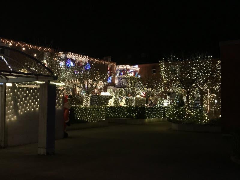 Christmas illumination of spot lights on house walls ans windows Urdorf Switzerland. Christmas illumination of spot lights on house walls and windows Urdorf stock images