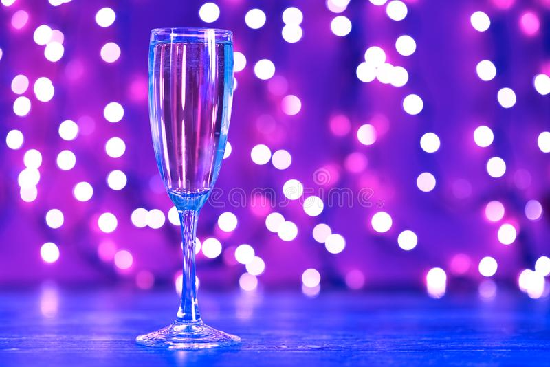 Christmas illuminations and champagne glass. In neon light stock photos