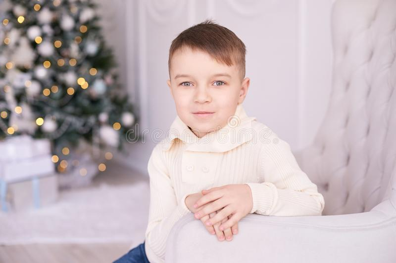 Christmas interior. Beautiful portrait. Little boy. Horizontally royalty free stock image