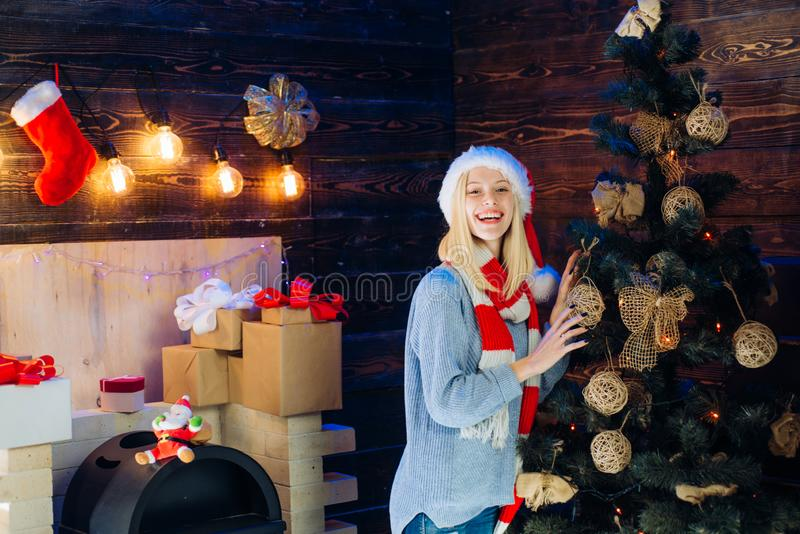 Christmas interior. Funny christmas girl. Winter holidays and people concept. True Emotions. Funny. Having fun. Funny. Laughing Surprised Woman Portrait stock photo