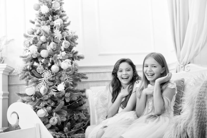 Christmas interior. xmas online shopping. Family holiday. Happy new year. Winter. The morning before Xmas. Little girls. Christmas tree and presents. Child stock images
