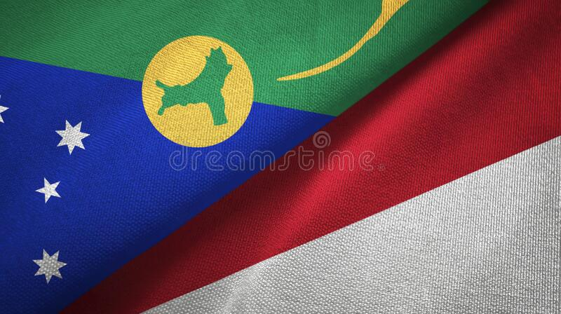 Christmas Island and Indonesia two flags textile cloth, fabric texture. Christmas Island and Indonesia flags together textile cloth, fabric texture stock photos