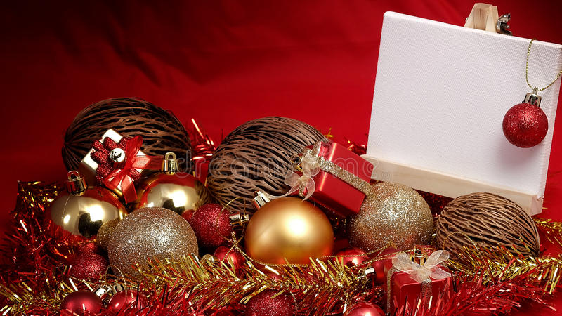 Christmas items in red and gold theme with white board standing for write wording. Christmas items in red and gold theme with white board standing for write word royalty free stock photo