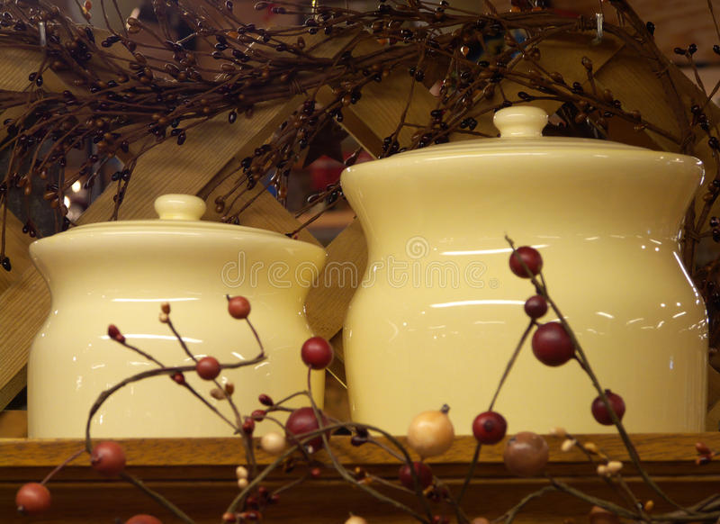 Christmas Jars. Two ceramic containers set within a viny decorative trellis stock photo