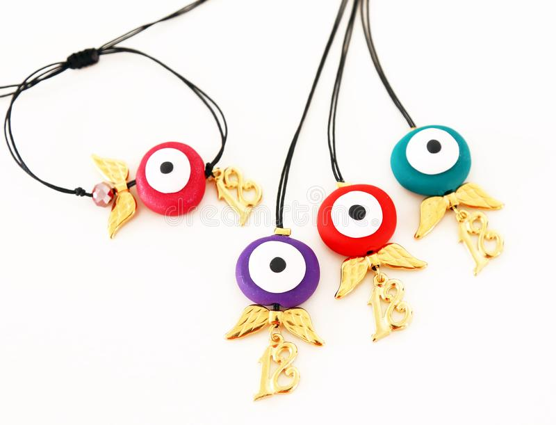 Christmas 2018 jewelry with evil eye and angel wings. Jewelry advertisement stock image