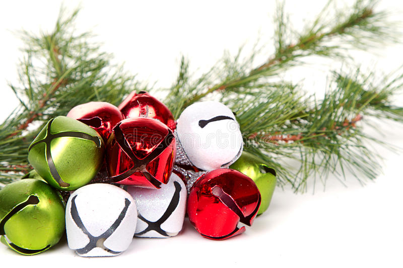 Christmas jingle bells and pine branch stock image