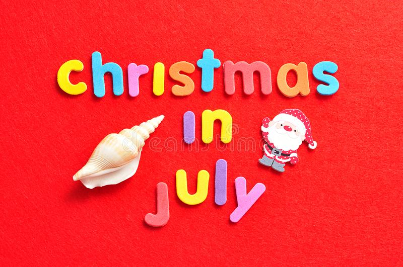 Christmas in July with a shell and a Santa Clause figure royalty free stock photo