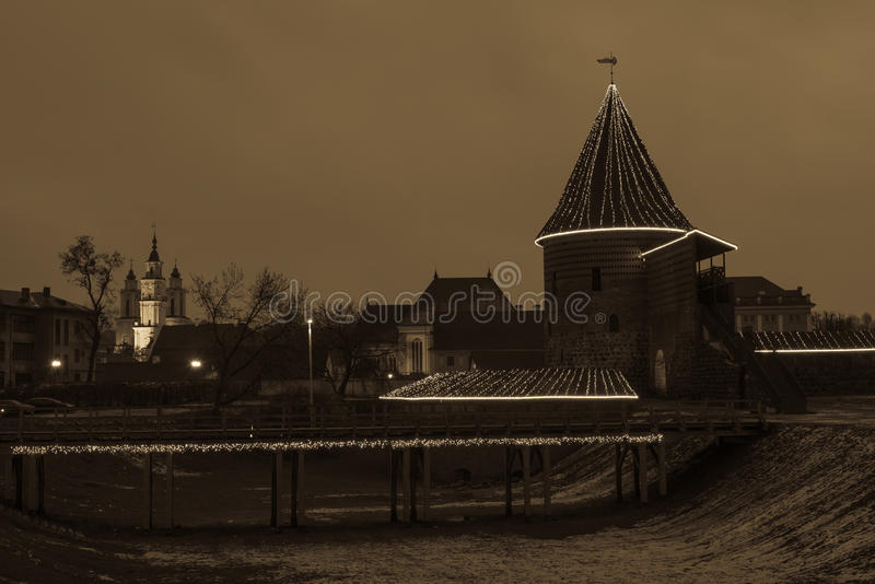Christmas in Kaunas castle night view toned image. Old castle in Christmas time illuminated with lights, Kaunas, Lithuania. Night scene, toned image stock photos