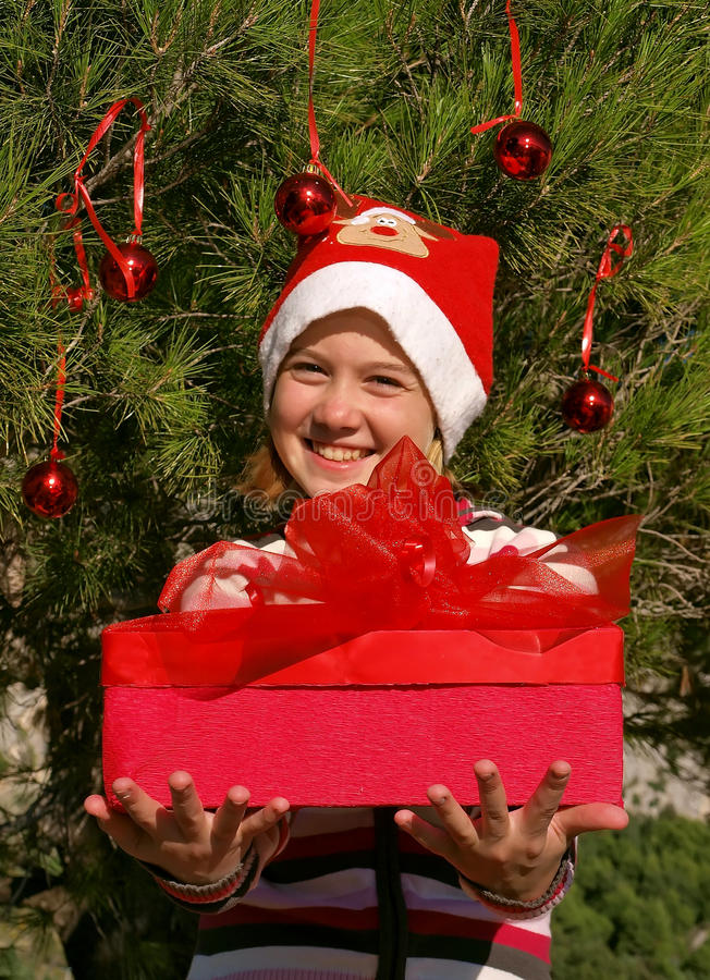 Christmas kid giving a gift royalty free stock photography