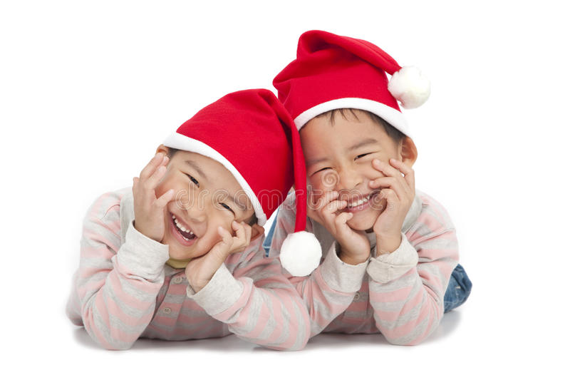Christmas kids in Santa hat. Isolated on white background stock photography