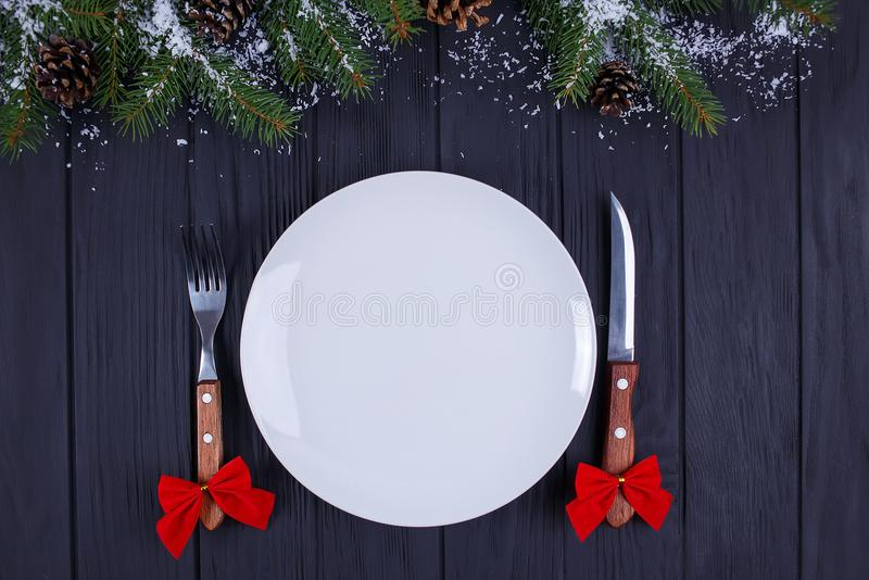 Christmas kitchen, festive dinner, holiday foods. Empty plate wi stock photo