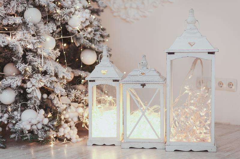 Christmas lantern with ornaments and snow in sepia tone near tree. royalty free stock photography