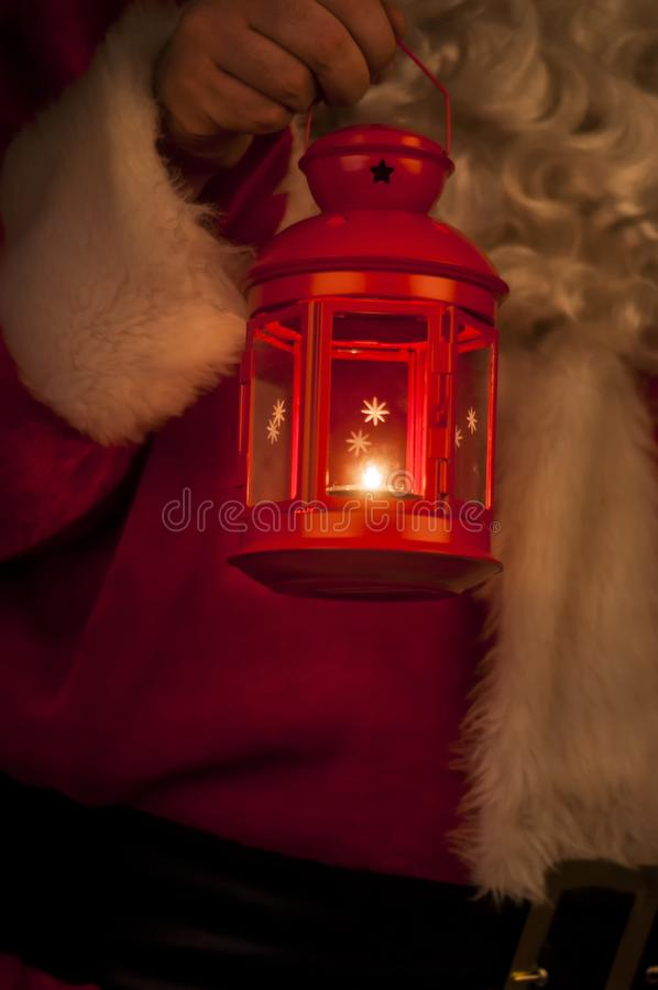 Christmas Lantern with Santa Claus in the Background stock photos