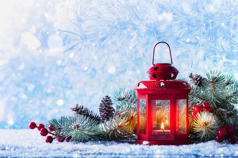 Christmas lantern in snow with fir tree branch. Winter cozy scene. Christmas lantern in snow with fir tree. Winter cozy scene royalty free stock photography