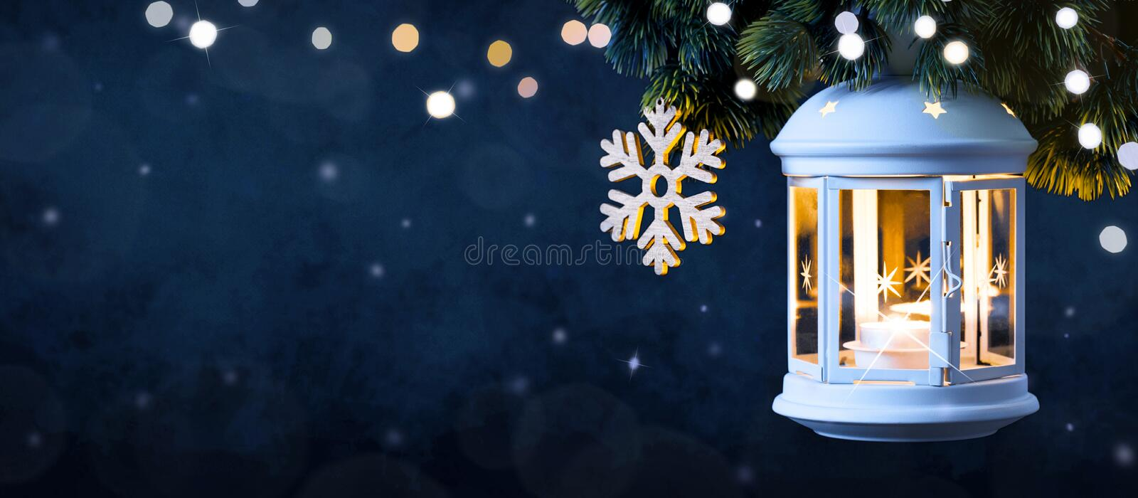 Christmas Lantern On Snow With Pine Branch. Happy New Year card royalty free stock photos