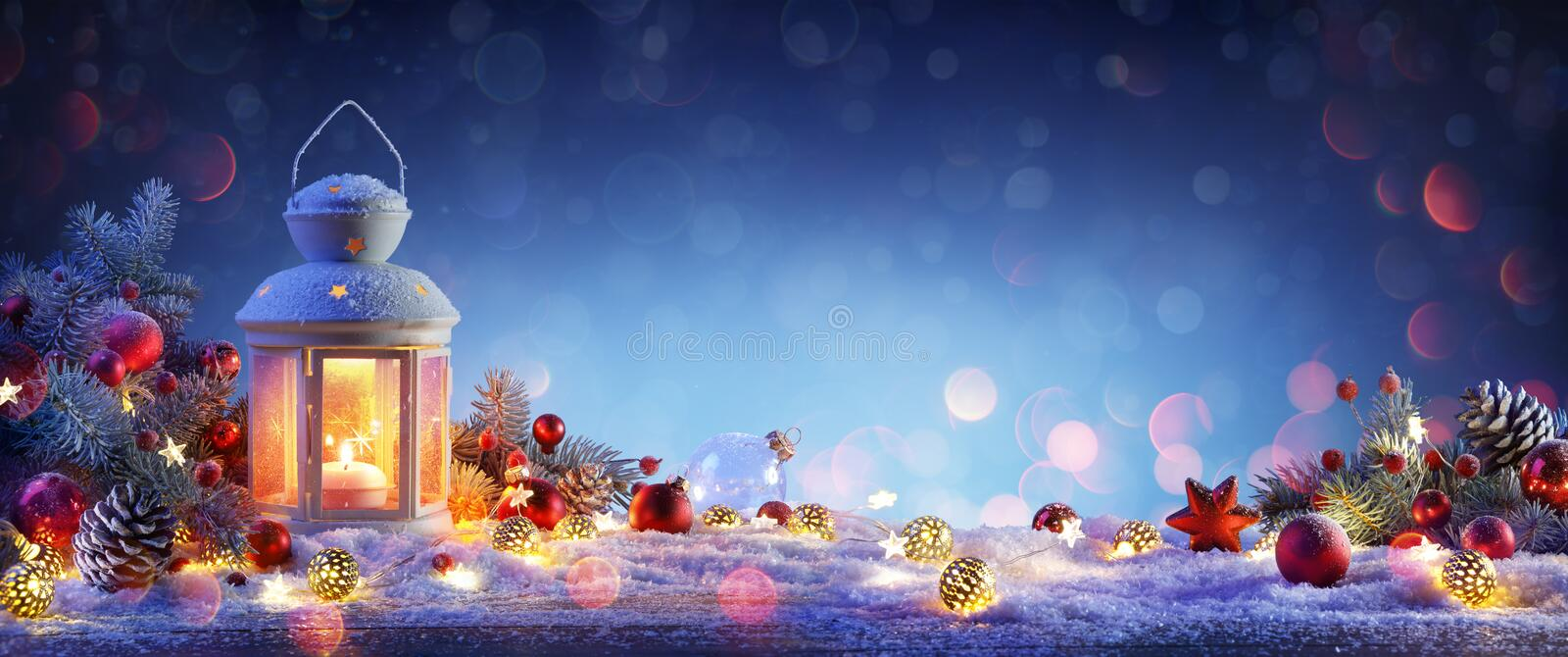 Christmas Lantern On Snowy Table With Fir Branches stock images