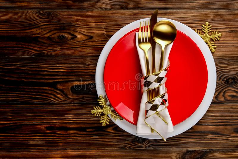 Christmas laying table appointments, table setting options. Silverware, tableware items with festive decoration stock photo