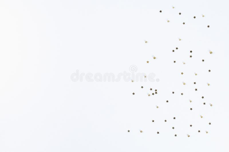 Christmas layout. Golden confetti in the form of stars on a white background. New Year 2019, christmas, winter concept. Copy space royalty free stock photography