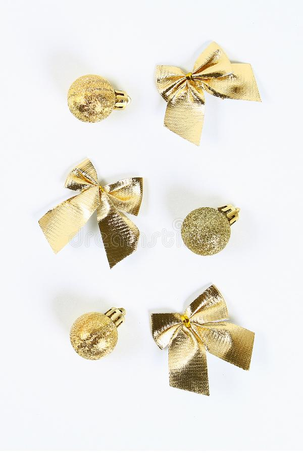Christmas layout. Golden toy ball, bow on a white background. New Year, christmas, winter concept royalty free stock image