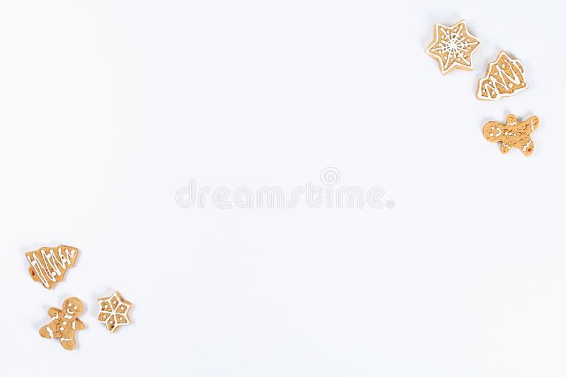 Christmas layout. homemade ginger cookies on a white background. New Year 2019, christmas, winter concept. Copy space, tov view, royalty free stock photo