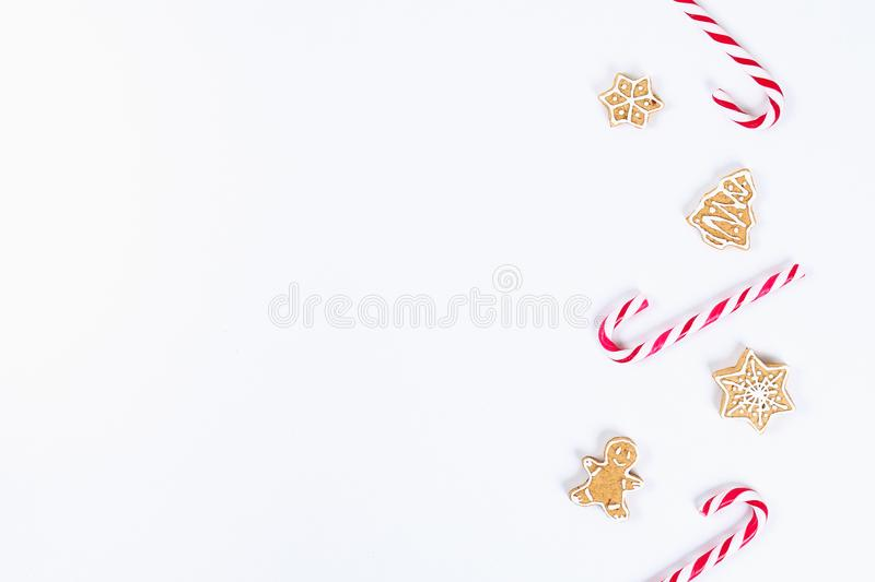 Christmas layout. Striped red-white cane candies and homemade ginger cookies on a white background. New Year 2019, christmas, royalty free stock images
