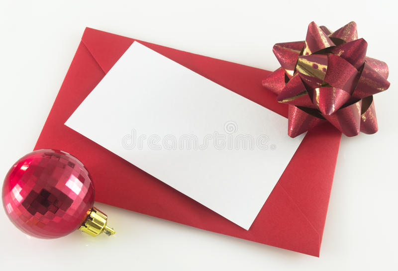 Christmas letter. Blank Christmas letter on red envelope and decorations royalty free stock photography