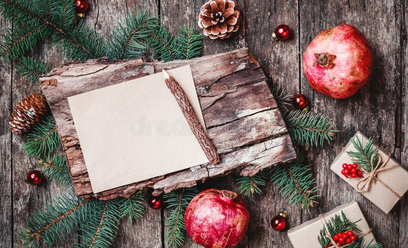 Christmas letter on wooden background with Christmas gifts, bark texture, pencil, Fir branches, pine cones stock image