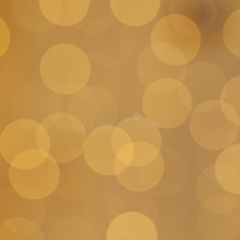 Christmas light background with holiday glowing backdrop. Defocused background with golden blinking stars.  stock photography