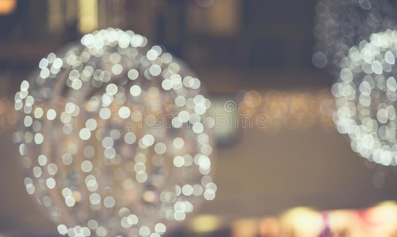 Christmas light background. Holiday glowing backdrop. Defocused Background With Blinking Stars. Blurred Bokeh. stock photos