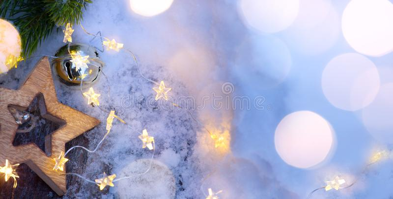 Christmas Light background. Xmas tree with snow decorated with garland star lights, holiday festive backdround. New year Winter or Christmas scene royalty free stock photography