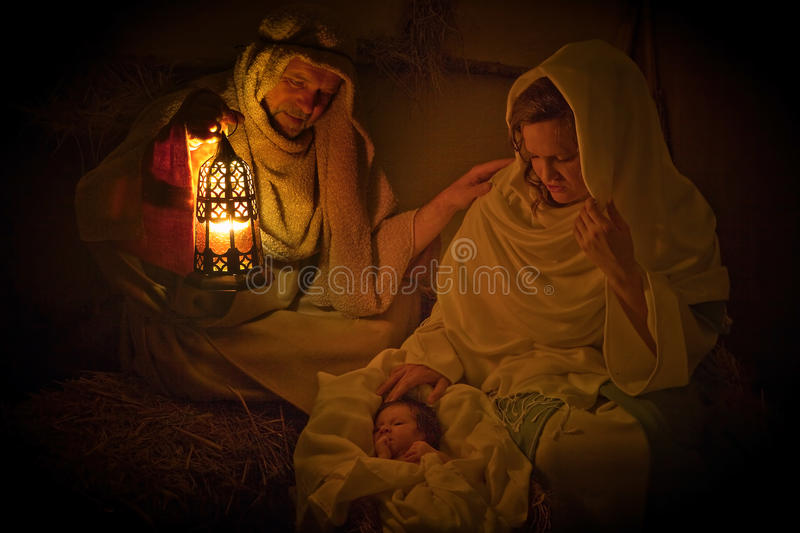 Christmas light in a manger stock photography