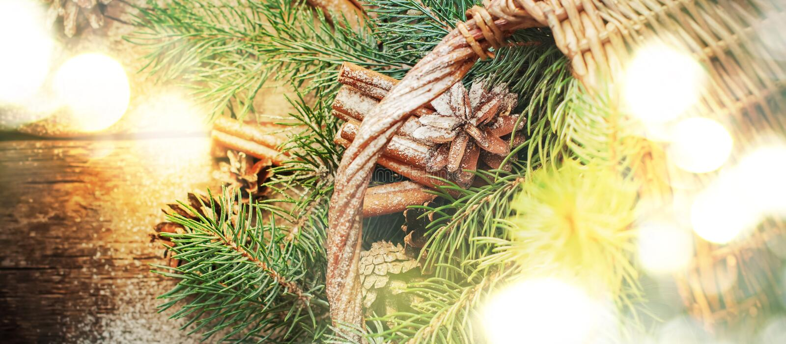 Christmas Light with Natural Gifts, Pine Cones, Fir Tree, Cinnamon. Top view stock photo