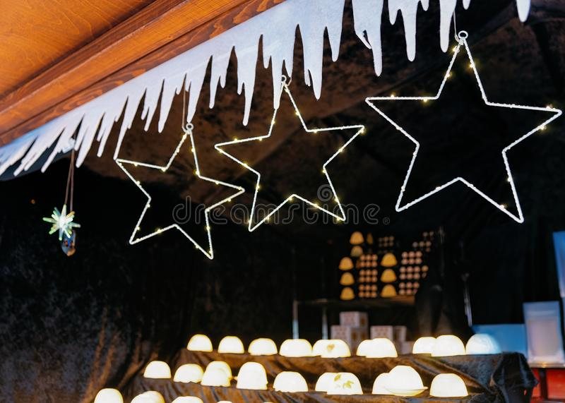 Christmas light star decorations at Christmas Market at Town Hall in Winter Berlin, Germany. Advent Fair and Stalls with Crafts. Items on the Bazaar stock photography