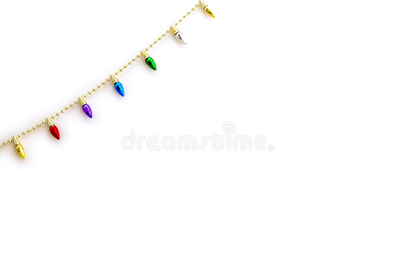 Christmas light string decor corner border. Isolated on white stock images