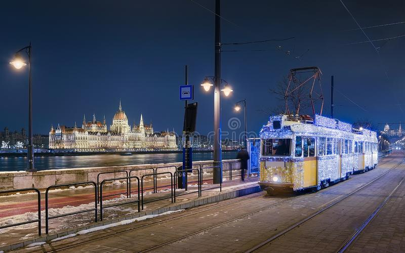 019 Christmas light tram with Danube river and old, historical Hungarian parliament building. 2019 Christmas light tram with Danube river and old, historical royalty free stock images