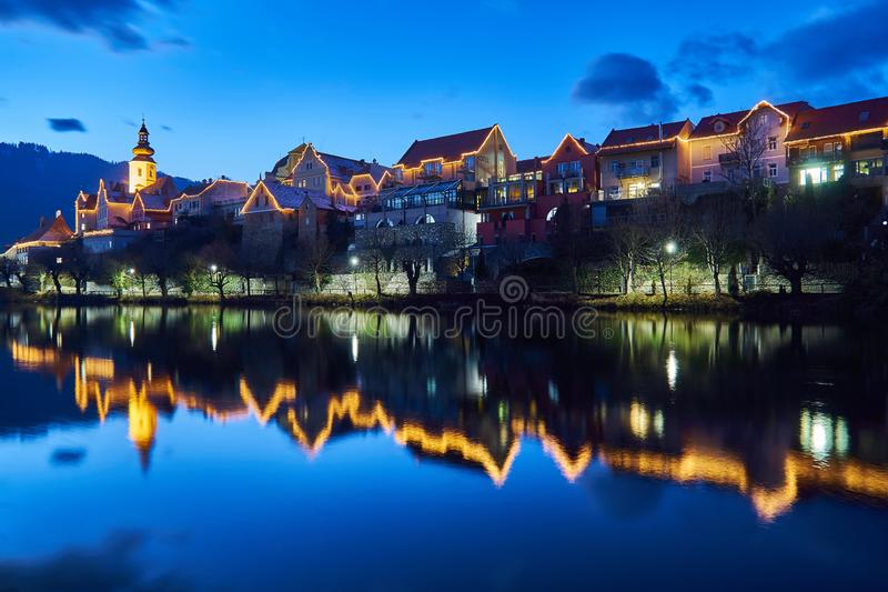 Christmas lighting in Frohnleiten, Styria. Beautiful christmas lighting of Austrian City Frohnleiten and reflection on the river in front royalty free stock photos