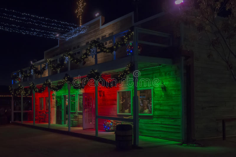 Christmas Lighting of Old Wild West Store. Colorful and festive Christmas holiday lighting of old wild west general store royalty free stock image
