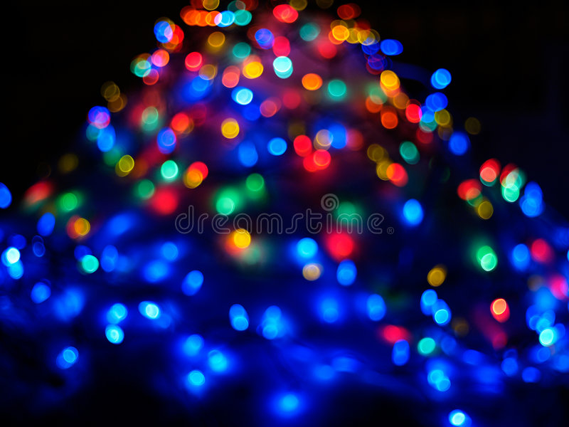 Christmas lights. On a snow pile while zooming out stock image