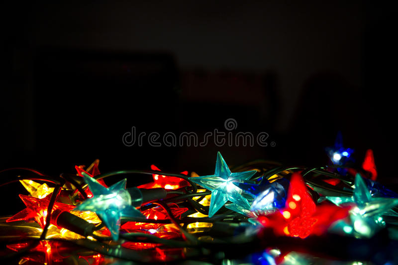 Christmas lights against black background royalty free stock photos