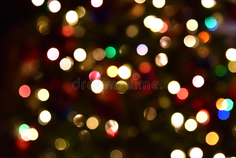 De-focused, sparked, artistic Christmas lights background. Christmas lights background. Ideal background for greeting card or a poster royalty free stock images