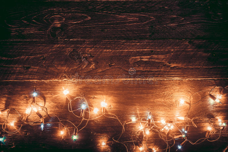 Christmas lights background. Merry christmas xmas background. Old wood texture - vintage styles stock photography
