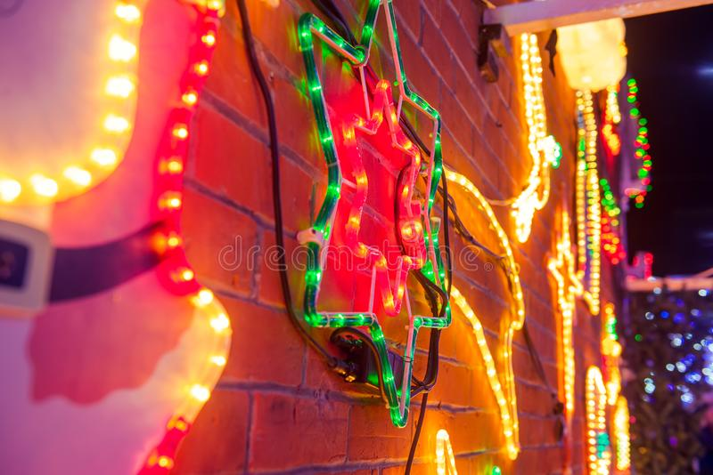 Christmas Lights Background. Nativity star, blurred lights and outdoor decorations. Merry Xmas and New Year outside exterior decor stock photography