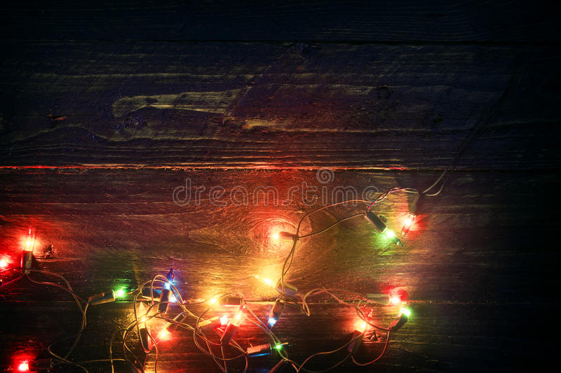Christmas lights background - Rustic Merry christmas xmas background. With plank wood with colorful lights and free text space. vintage styles royalty free stock photos