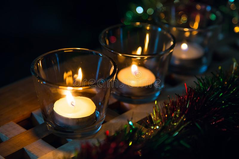 Christmas lights background with tea candles royalty free stock image